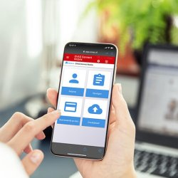 Businesswoman points smartphone screen and checks calendar on application. Application on screen created in graphic program